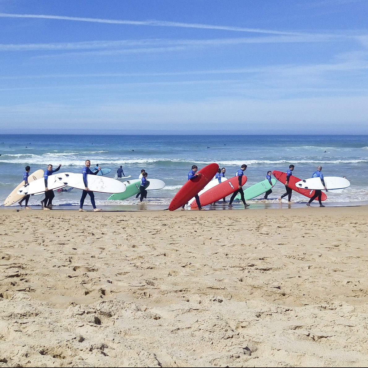 darling associates team surfing in portugal